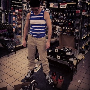 Me trying on skates, different size on each foot.