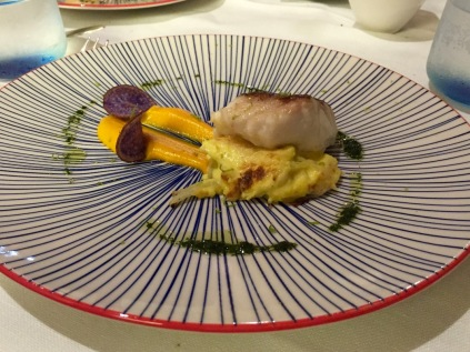 Fillet of local red snapper on fennel gratin with lime, carrot ginger cream puree