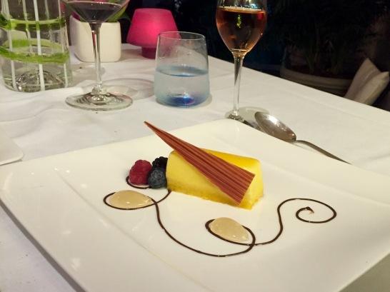 Babà and white chocolate mousse, orange glaze and rum sauce